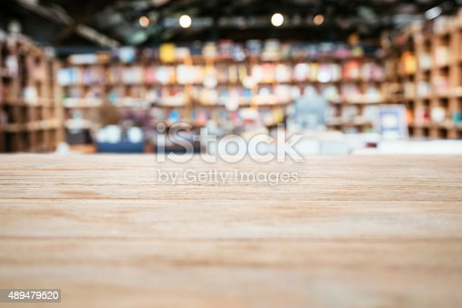 istock Table top Counter with Blurred Bookshelf Bookstore Background 489479520