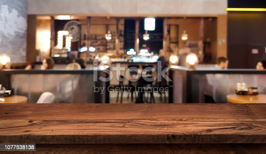 istock Table top counter with blurred people and restaurant interior background 1077538138