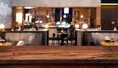 Table top counter with blurred people and restaurant interior background