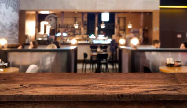 Table top counter with blurred people and restaurant interior background Table top counter with blurred people and restaurant interior background cafe stock pictures, royalty-free photos & images