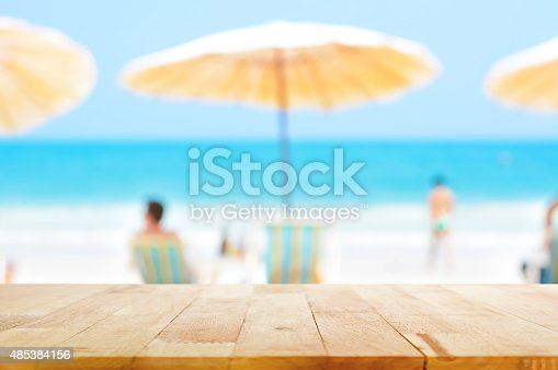 istock Table top on blurred background of people at the beach 485384156