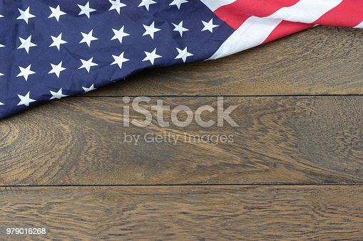 518726782 istock photo Table top view 4 th July independence day holiday background concept.Flat lay USA flag for sign of season on modern rustic brown wooden at office desk.Free space for creative design text & content. 979016268