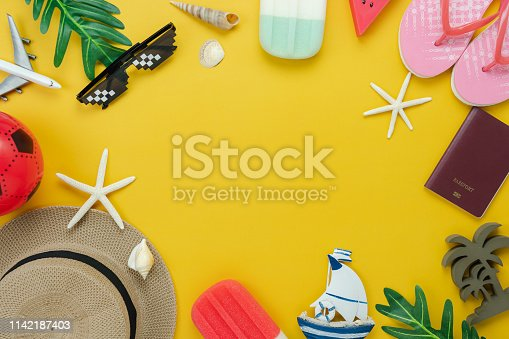istock Table top view accessory of clothing women  plan to travel in summer holiday background concept.Ice cream with many essential items hat & sunglasses on modern rustic yellow paper.Space for design. 1142187403
