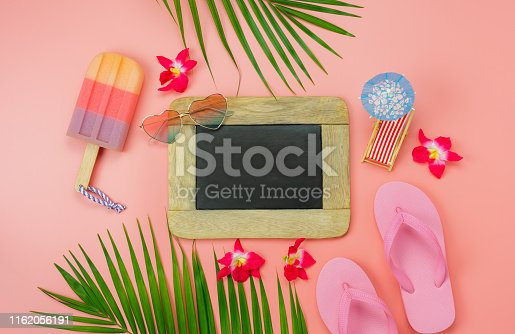 699960484istockphoto Table top view accessory plan to travel beach in summer holiday background concept.Flat lay  palm leaf with many essential items flower & palm leaf on pink paper.Blackboard for creative design text. 1162056191