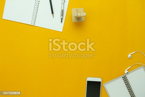 istock Table top view aerial image of accessories office desk background concept.Flat lay of variety object the mobile phone & pen and coffee with earphone on modern rustic white wooden with copy space. 1047035828