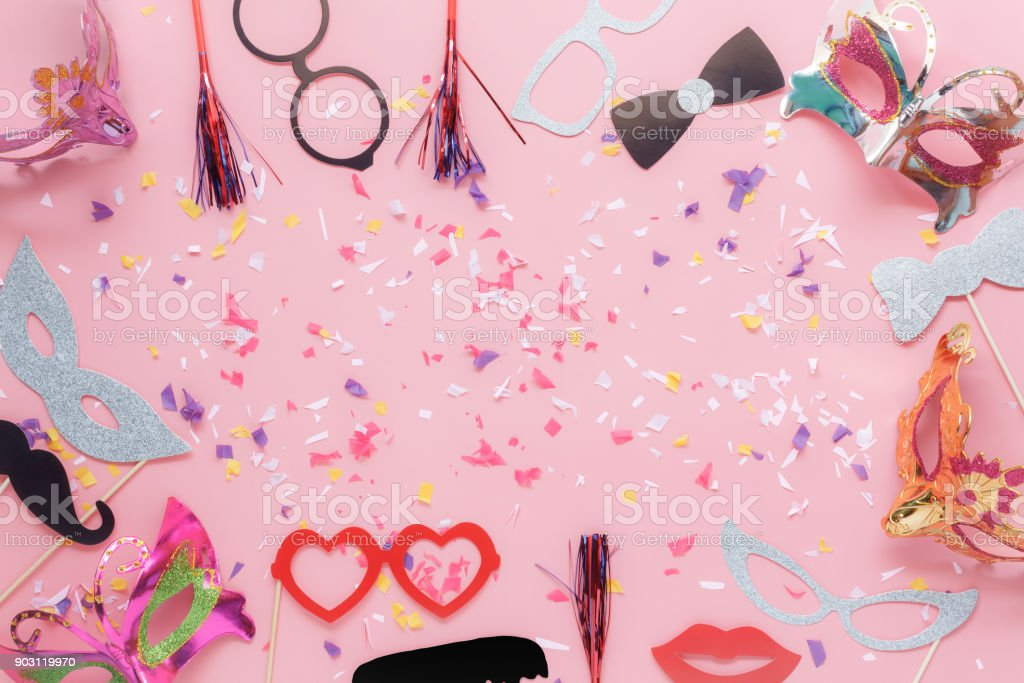 Table top view aerial image of beautiful photo booth prop for party carnival background concept.Flat lay objects with paper craft on modern rustic pink wallpaper at home office desk with copy space. stock photo