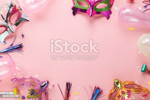 istock Table top view aerial image of beautiful photo booth prop for party carnival background concept.Flat lay objects with paper craft on modern rustic pink wallpaper at home office desk with copy space. 909089298