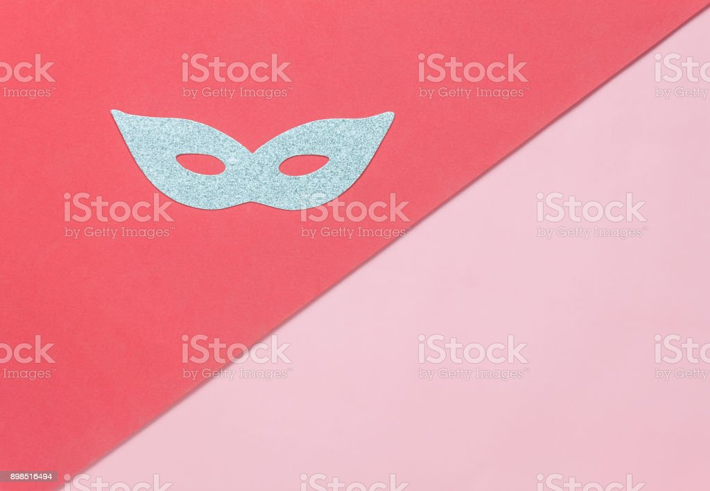 Table top view aerial image of beautiful silver carnival mask or photo booth prop background.Object on modern rustic red & pink wallpaper at home office desk studio.space for creative design text. stock photo