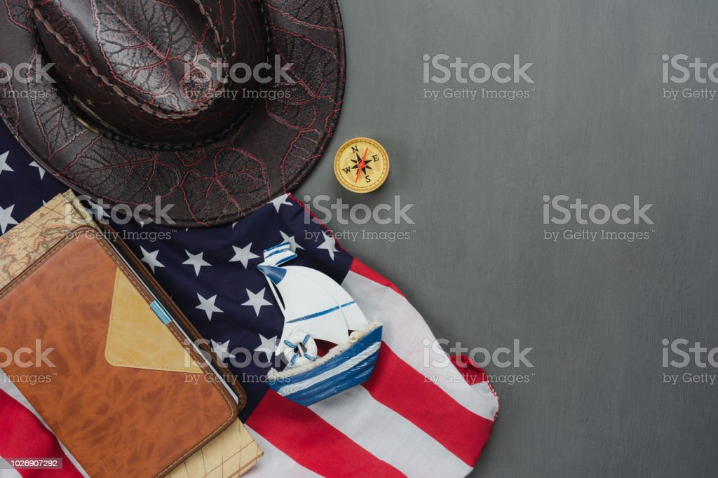 Table top view aerial image of decoration the sign of USA Happy Columbus day on Oct 8,2018 background concept.Flat lay accessories US flag and sign season on modern rustic grey wooden.Space for design stock photo