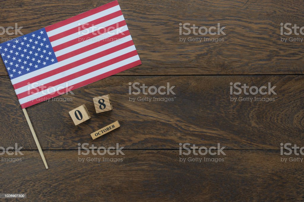 Table top view aerial image of decoration the sign of USA Happy Columbus day on Oct 8,2018 background concept.Flat lay accessories US flag and date & month wood box on modern rustic brown wooden. stock photo