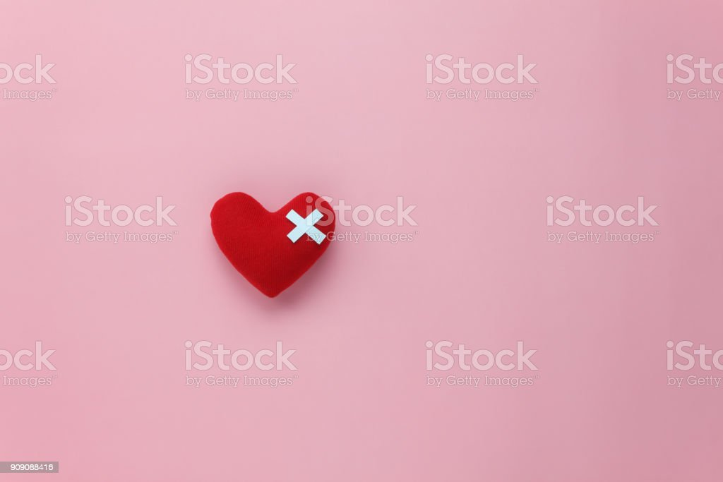 Table top view aerial image of decoration valentine's day background concept.Flat lay red heart with design injury on modern rustic pink paper.pastel tone.copy space for creative text & font. stock photo
