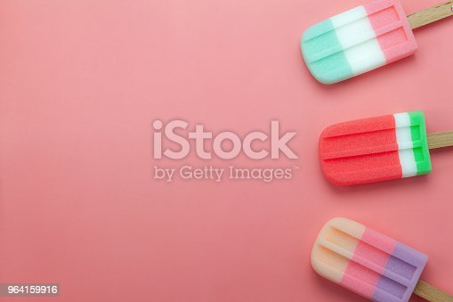 istock Table top view aerial image of food for summer holiday background concept.Flat lay arrangement variety ice cream pop stick on modern rustic pink paper wallpaper at office desk.Pastel tone design. 964159916