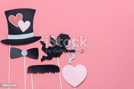 istock Table top view aerial image of sign valentine 's day background concept.Photo booth props on modern grunge pink wallpaper at home office desk studio.Space for creative design mock up & templates. 898516488