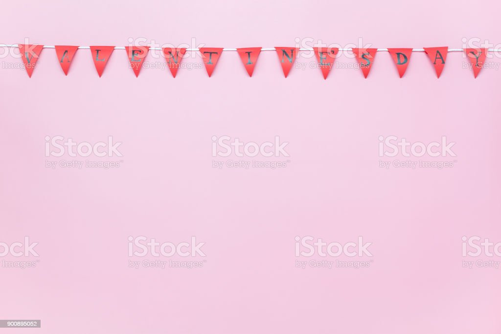 Table top view aerial image of Valentine 's day background concept.Valentines flag or Party banner on modern rustic pink wallpaper at home office desk studio.free space for creative design mock up. stock photo
