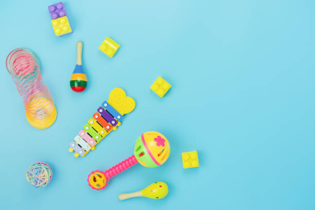 Table top view decoration kid toys for develop background concept.Flat lay accessories baby to play with items child on modern blue paper at office desk.Copy space for add text.pastel tone wallpaper. stock photo