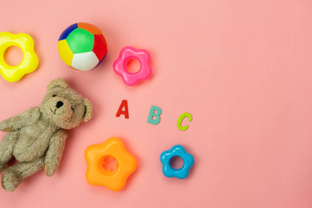 Table top view decoration kid toys for develop background concept.Flat lay accessories baby to play with items child on modern pink paper at office desk.Copy space for add text.pastel tone wallpaper. stock photo
