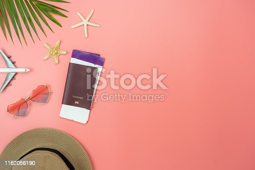 699960484istockphoto Table top view food items of travel summer holiday & vacation background concept.Flat lay arrangement of passport  palm airplane on modern rustic pink paper.copy space for creative design text 1162056190