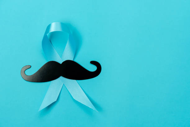 Table top view Happy Fathers day holiday  or International health Men's day background concept.Flat lay sign for festival the blue ribbon with black mustache on modern paper.copy space for deign. stock photo