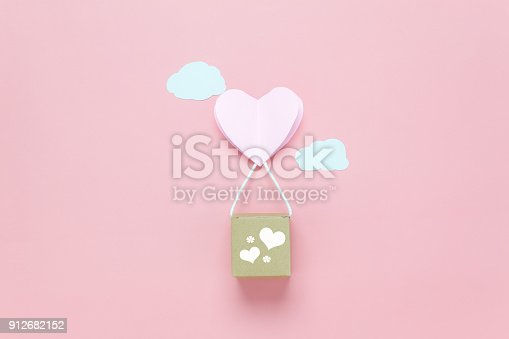 istock Table top view image of decoration valentine's day background concept.Text sign of season with paper cut balloon love on beautiful pink sky with cloud.Several objects on pink wallpaper.pastel tone. 912682152