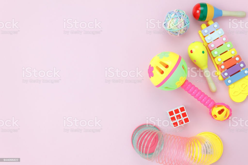 Table top view image the kids toys for development background concept.Flat lay accessory objects for children on modern rustic pink at home office desk.Design pastel tone with copy space for add text. stock photo