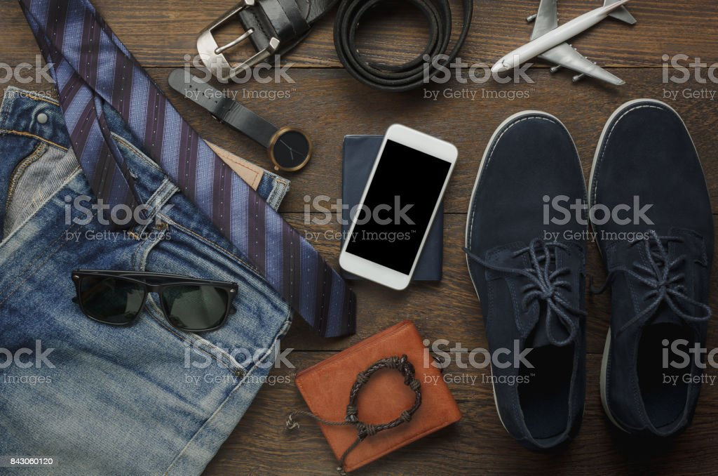 Table top view of accessories fashion men for travel with technology...