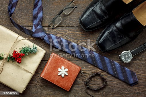 istock Table top view of accessories men fashion to travel with decorations & ornaments merry Christmas & Happy new year festival concept.Essential items prepare for traveler adult or teen at season. 865548580