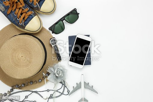 istock Table top view of accessory travel and fashion women with technology concept background.Difference objects for traveler with copy space.Essential items for trip on the white wooden at office desk 862254742