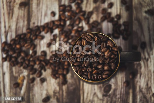 istock Table Top View of Coffee Beans and Cup 1135132175