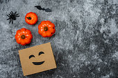 istock Table top view  of decoration Happy Halloween day background concept.Flat lay accessories essential object to shopping the pumpkin & sweet candy with jack o lantern on rustic stone.copy space design. 1179502417