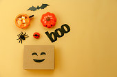 istock Table top view  of decoration Happy Halloween day background concept.Flat lay accessories essential object to shopping the pumpkin & sweet candy with jack o lantern on yellow paper.copy space design. 1179502426