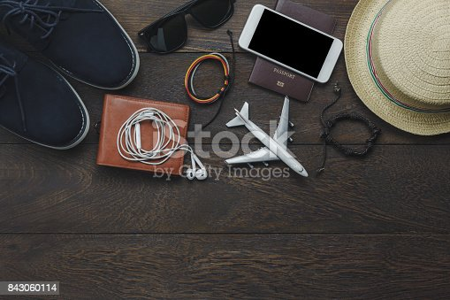 istock Table top view of essential item gentlemen for travel with technology background concept.Mix variety object on modern rustic wood office desk.Several  accessories for men travel to holidays trip. 843060114