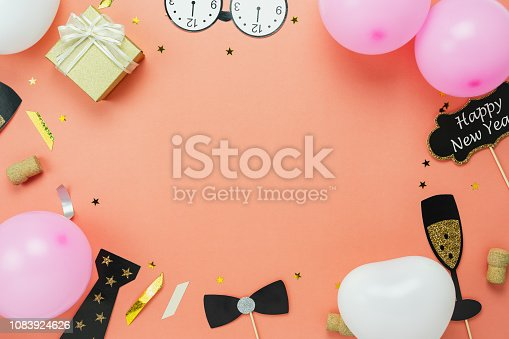 Table top view of Merry Christmas decoration & Happy new year 2019 ornament concept.Flat lay the photo booth prob and gift box & balloon with golden confetti on modern pink paper background.copy space