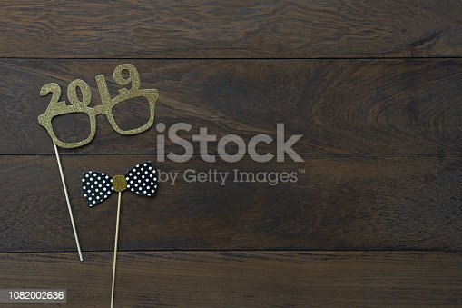 Table top view of Merry Christmas decorations & Happy new year 2019 ornaments concept.Flat lay essential difference objects to party season the photo booth prob on modern wooden brown background.