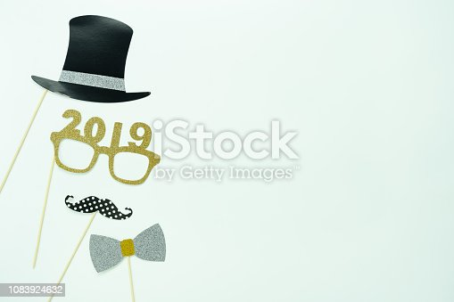 Table top view of Merry Christmas decorations & Happy new year 2019 ornaments concept.Flat lay essential difference objects to party season the photo booth prob on modern white wooden  background.