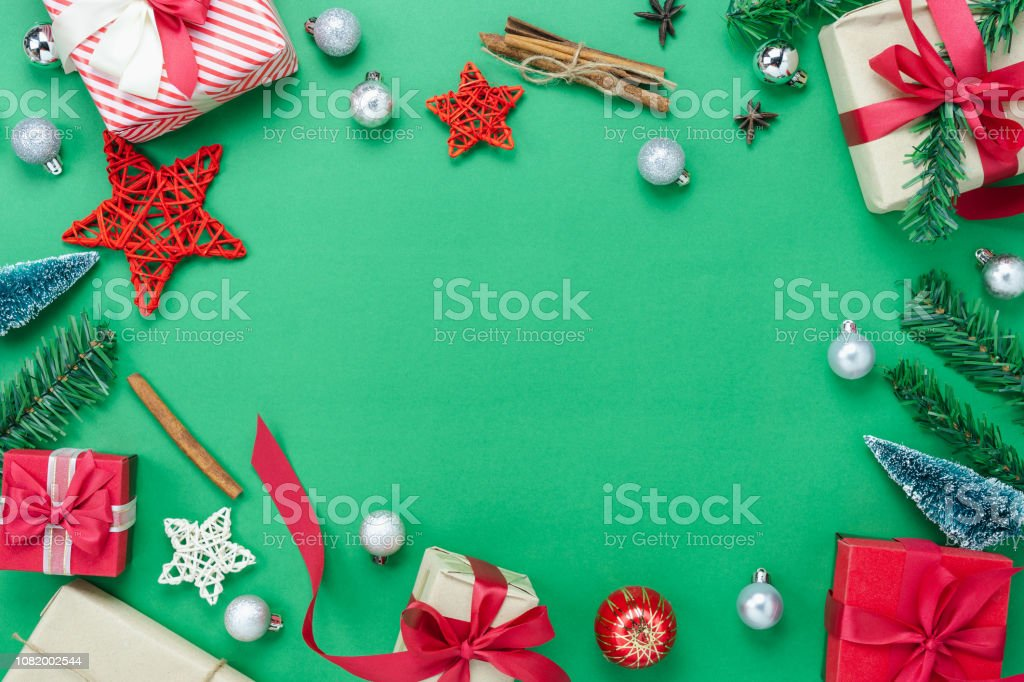 Essential Christmas Decorations.Table Top View Of Merry Christmas Decorations Happy New Year Ornaments Conceptflat Lay Essential Objects The Fir Tree Gift Box On Modern Rustic Green