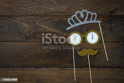 Table top view of wedding celebrate decorations & Happy new year 2019 ornaments concept.Flat lay essential difference objects to party season the photo booth prob on modern wooden brown background.