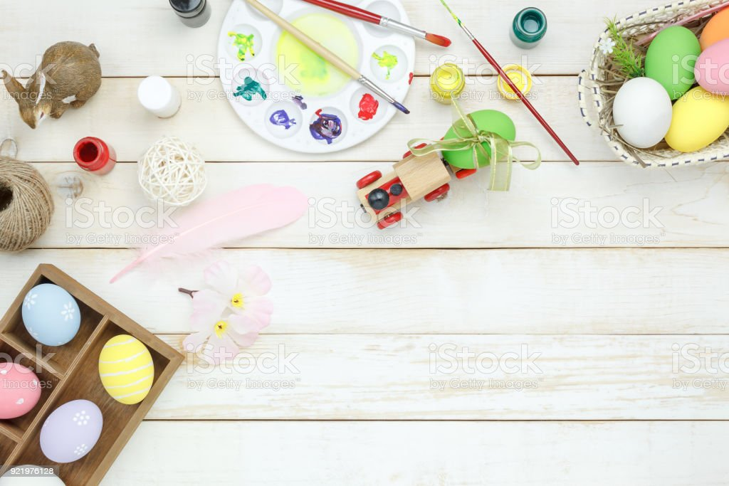 Table top view shot of decoration Happy Easter holiday background concept.Arrangement item to paint activity on the modern rustic white wooden table at home office desk.Negative space for creative. stock photo