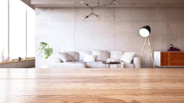 モダンなリビングルームのインテリアのぼかしとテーブルトップ - テーブル 無人 ストックフォトと画像