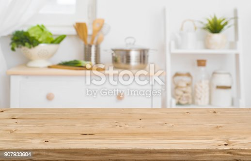 Table top with blurred kitchen furniture as background
