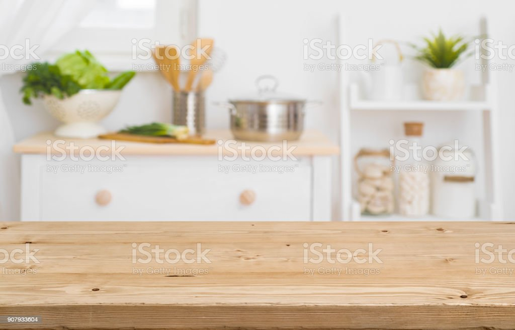 Table top with blurred kitchen furniture as background stock photo