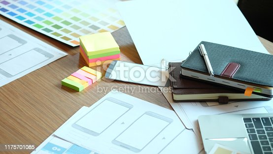 Table where ux ui works, Application development mobile application, Developer workspace.
