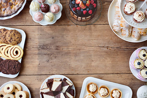 table with cake, pie, cupcakes, tarts and cakepops. copy space. - tatlı stok fotoğraflar ve resimler