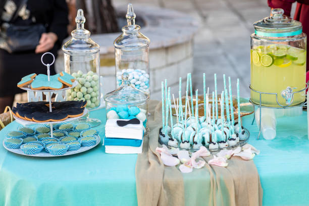 table with cakes for the baptism stock photo