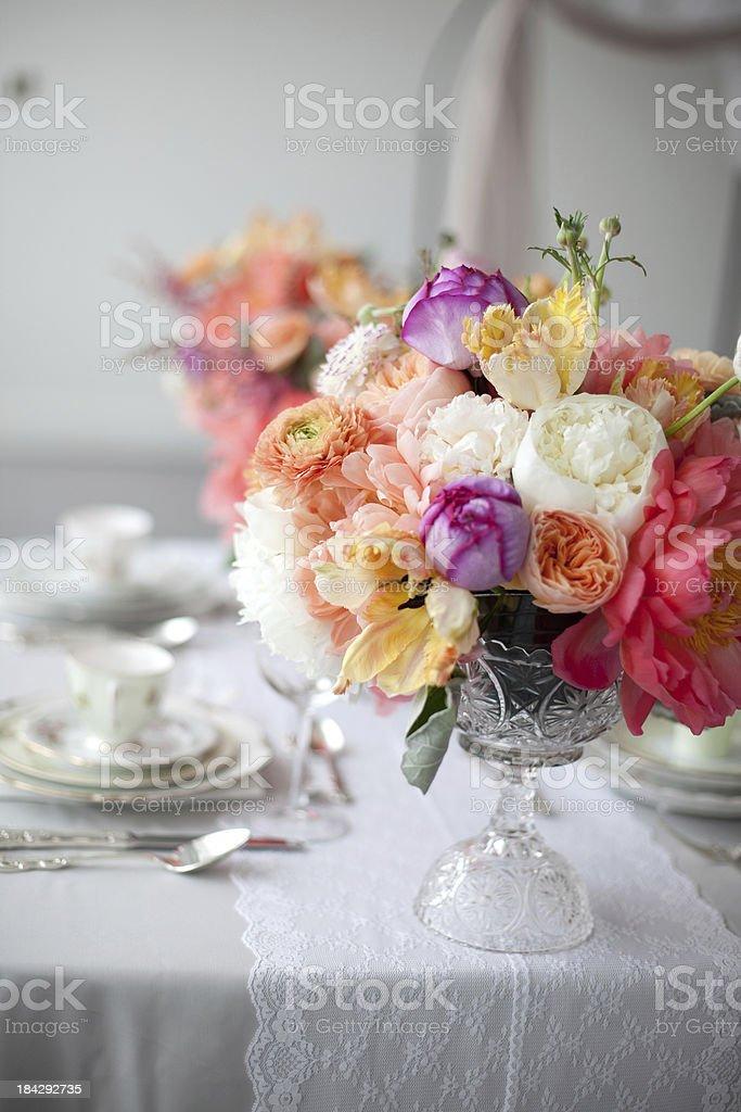 Table with centerpieces at a party stock photo