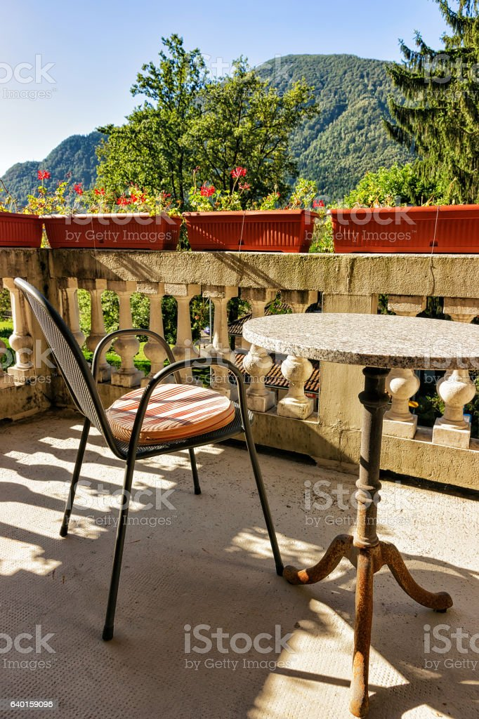 Table with chairs on the open balcony veranda stock photo