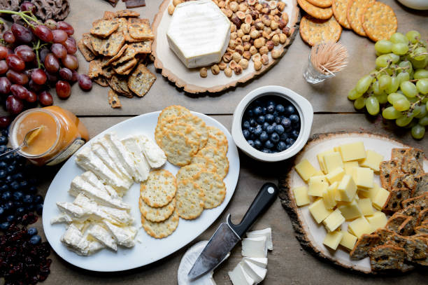 Table with cheese and fruit spread out for a party stock photo
