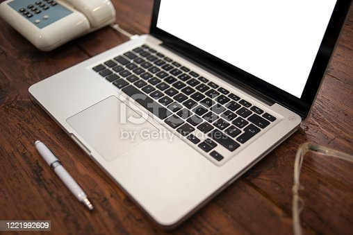 1128886313 istock photo Table with computer and telephone 1221992609