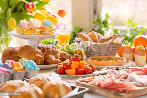 1131445181 istock photo Table with delicatessen ready for Easter brunch 1202231574