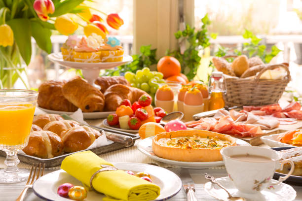 table with delicatessen ready for easter brunch - easter imagens e fotografias de stock