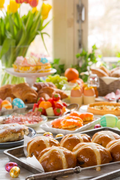 table with delicatessen ready for easter brunch - easter brunch stock photos and pictures